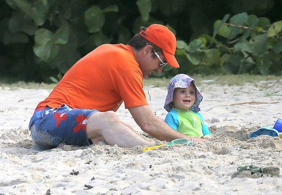 Robert Downey Jr messes about on the beach with son Exton