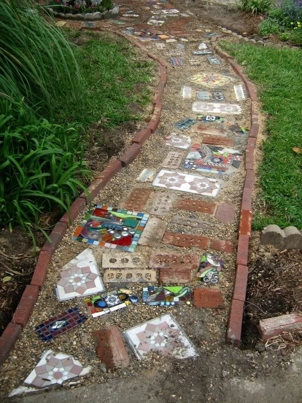 Broken ceramic mosaic garden pathways are enchanting.