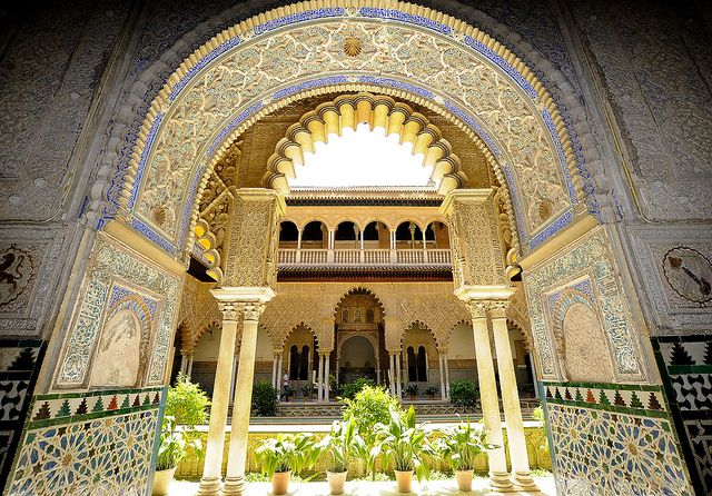 "The Alcázar of Seville (Spanish ""Alcázares Reales de Sevilla"" or ""Royal Alcazars of Seville"") is a royal palace in Seville, Spain, originally a Moorish fort."