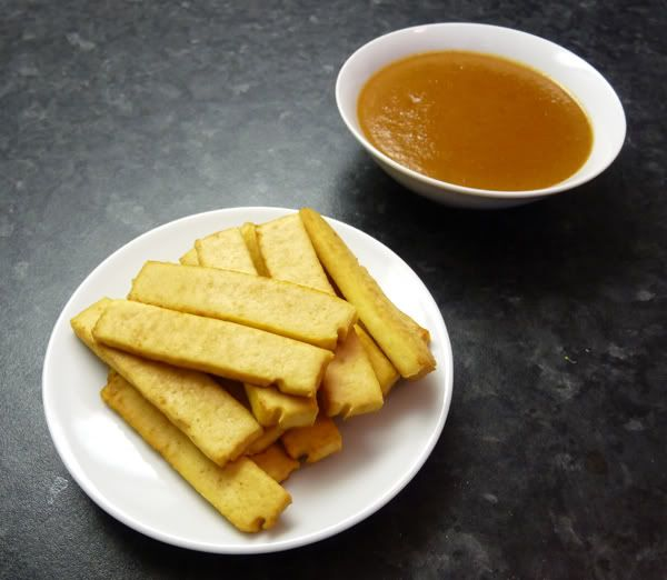 Baked tofu strips with peanut dipping sauce