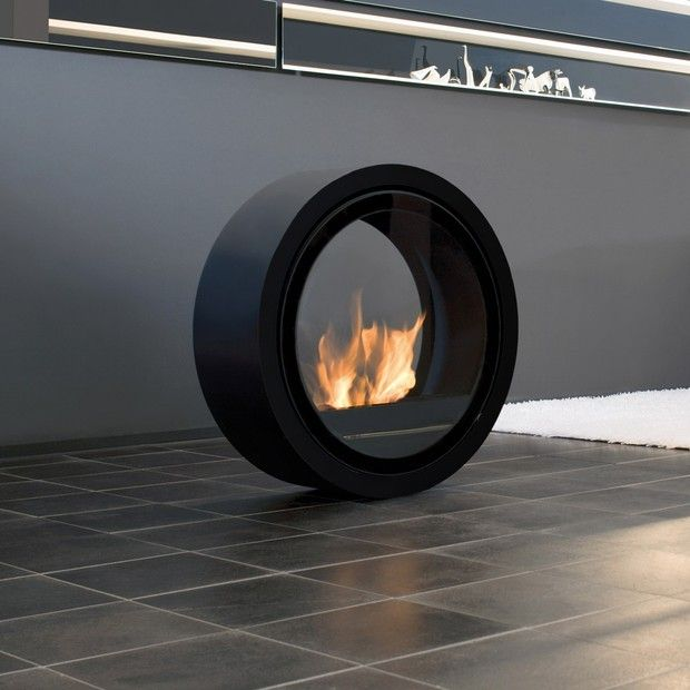 Movable Fireplace from Touch of Modern. The stainless steel tank, mounted on its roller bearings, allows for it to easily roll but also be fixed into a location. See video here http://www.conmoto.com/rollfire.html?=1