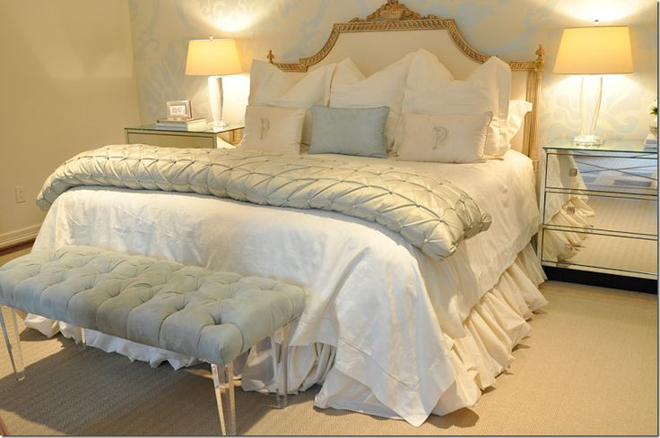 Neutral bedroom decor. White and cream bedding with pop of Provence blue