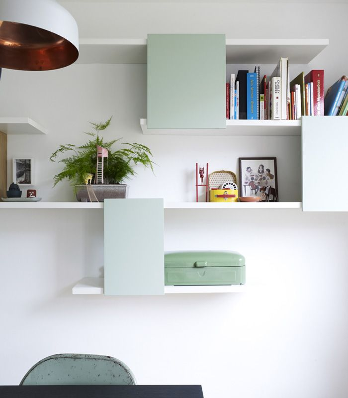 shelves with mint colored panels