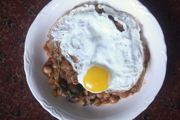 spanish chickpea stew. fried egg on top. there should be fried eggs on ...