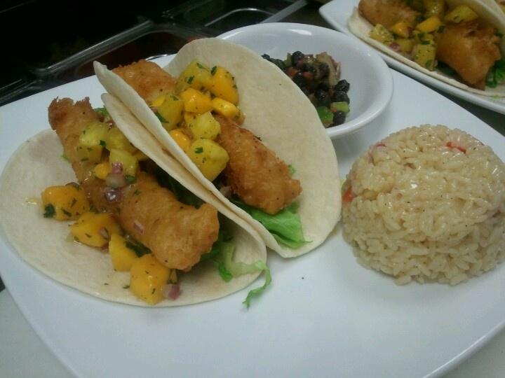 ... battered mahi tacos - topped with a spicy pineapple mango salsa, yum