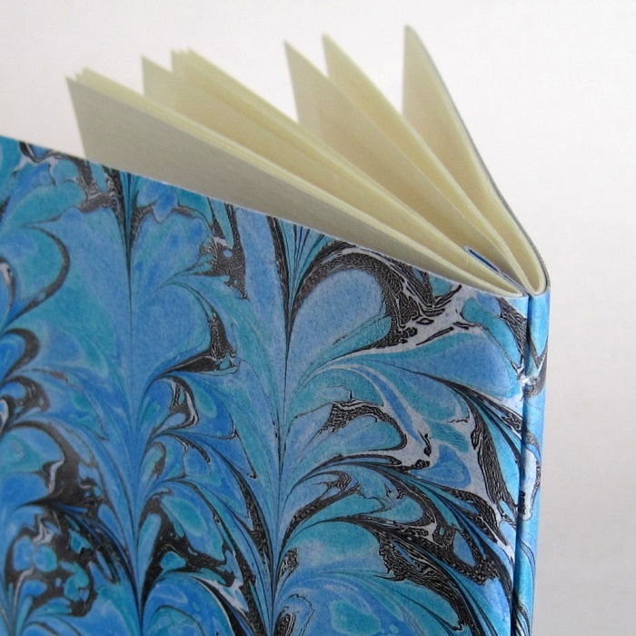 Double pamphlet stitch book with marbled paper covers