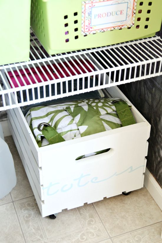 Put some casters on a crate to roll into the bottom of a closet!  Awesome for kids toys or in the entry closet for bags!