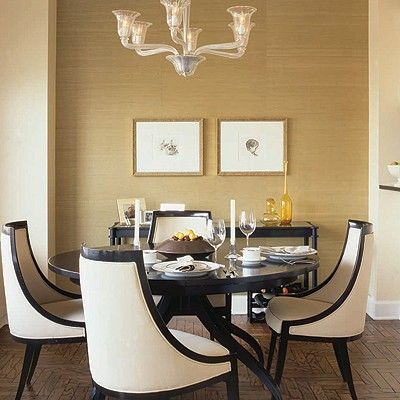 Chic dining room with grasscloth wallpaper and gorgeous chairs