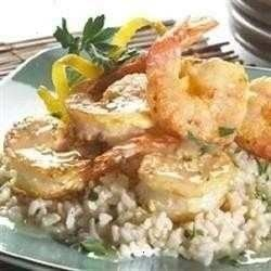 large shrimp and chunks of artichoke hearts are covered with crumbs, drizzled with garlicky butter and romano cheese, and baked in the oven for just a few minutes until shrimp are tender and pink.