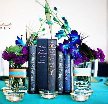 You may not want to make new decorations or hold onto the ones you buy, use things you already have as centerpieces. Here are some beautiful examples of how you can use books as centerpieces for your graduation party table.