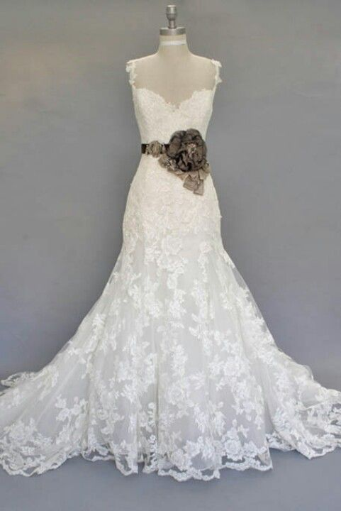 Rustic wedding dress! I would go without the giant rose though. that's a turn off.