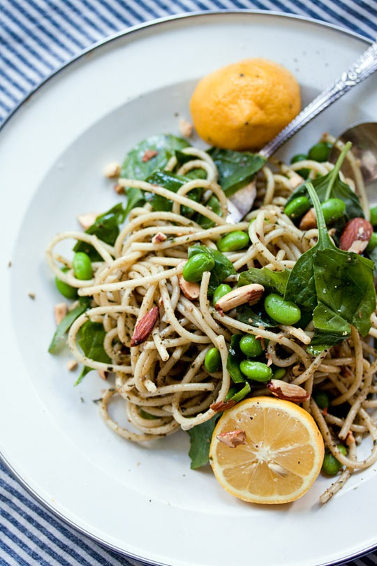 Pesto pasta with lemon, spinach, edamame and toasted almonds