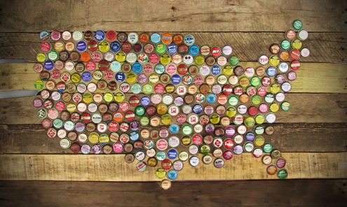 don't. Start saving them, get a few from your friends and family, make friends with a bartender, and resurrect them into some topographic wall art.   Fossil, the vintage-leaning accessory company, shows you how-to create a map of the U.S. in recyclables, securely attaching colorful bottle caps