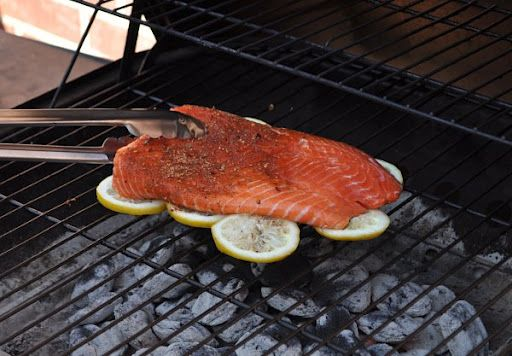 Grill your fish on a bed of lemons to infuse flavor & prevent sticking to the grill.  I need to try this out soon!