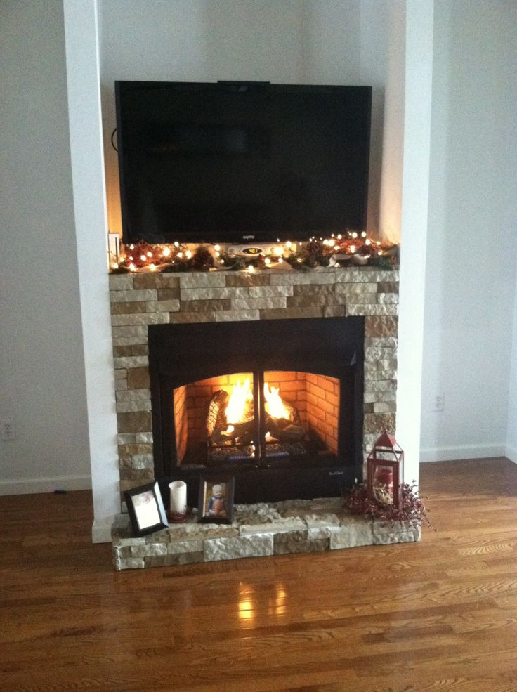 air stone fireplace with buck stove insert built in the fall of 2013