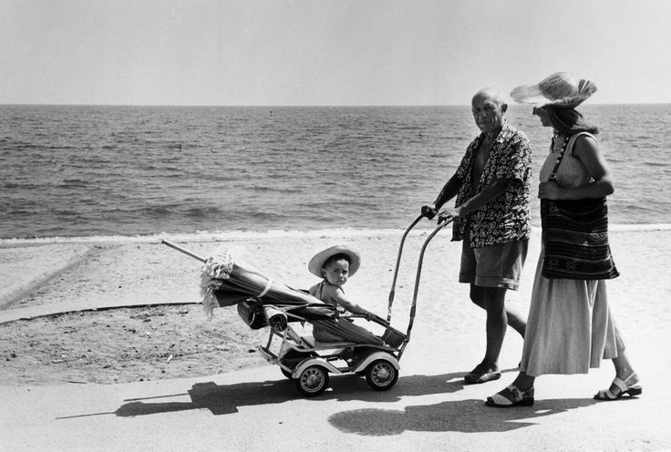 Picasso on the beach in Provence, France, with his son Claude and his partner Françoise Gilot, 1948. Photograph by Robert Capa/Magnum.