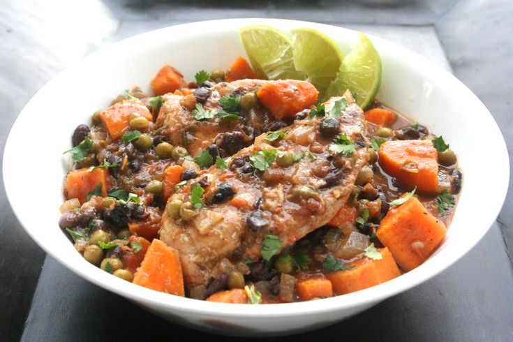 Slow-cooker Latin chicken with sweet potatoes, black beans and peas.