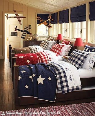 I love the idea of the same pattern but different colors for the bedding of the boys' room. These star quilts are pretty fabulous.