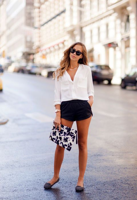 Black shorts and dress white shirt.