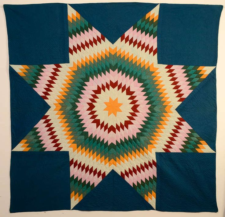 1870s lone star aka star of bethlehem quilt on a richly colored blue