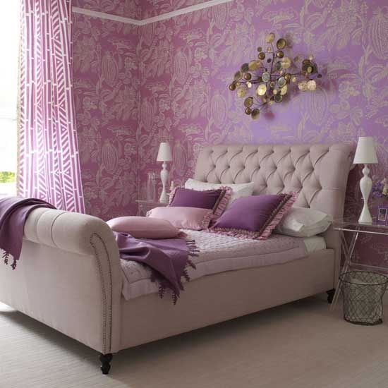 Gorgeous bedroom in shades of purple and lavender with gold accents and a tufted headboard | designlike.com