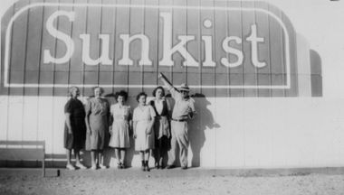 """Canoga Citrus Association employees, circa 1935-1945. In 1907, R.C. Brandon of the Lord & Thomas advertising agency suggested the brand name """"Sunkissed"""" be used for the citrus fruit grown for the California Fruit Growers Exchange. It was changed to """"Sunkist"""" shortly after and widely adopted by local citrus growers. Canoga-Owensmouth Historical Society. San Fernando Valley History Digital Library."""