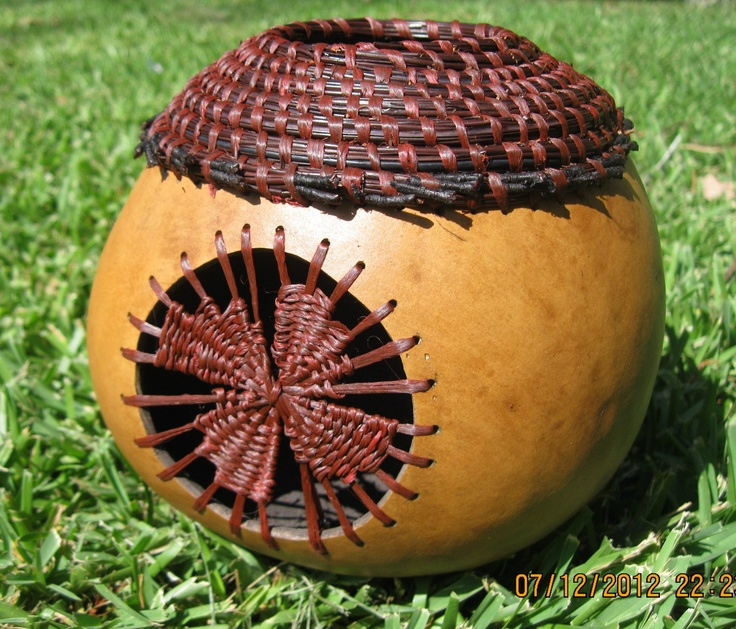 Coiled pine needles on gourd featuring teneriff center. $175.00, via Etsy.