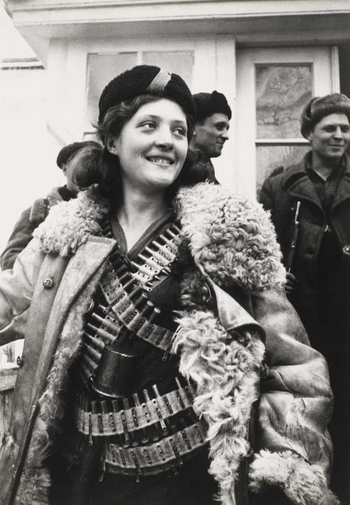 Female partisan, 1942. Photo by Arkady Shaikhet.