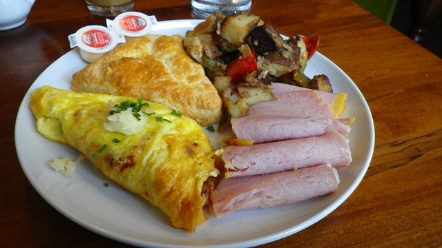 egg omelette with peppers, red onions, & cheddar. Peameal bacon.