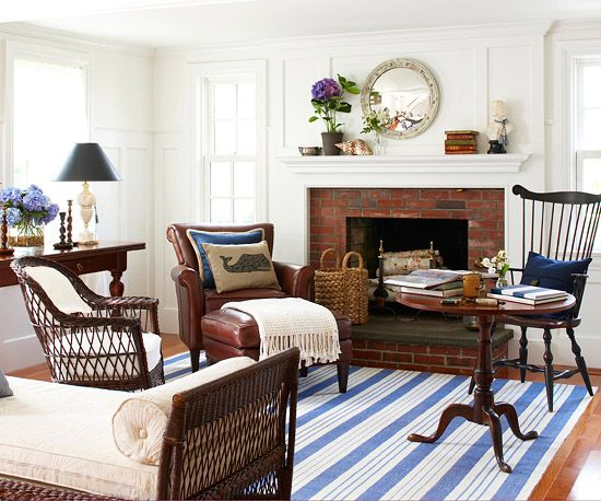 Classic Beauty    A white-and-blue color palette creates a classic look in this living room. Multiple shades of white for the walls, trim, and furniture complemented by accent pieces in light and dark hues of blue mimic the ocean and sky in this seaside cottage home.