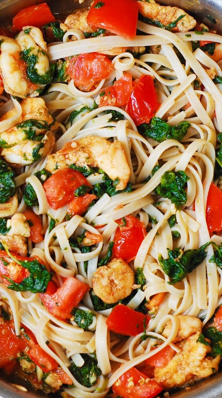 , fresh tomatoes, and spinach with fettuccine pasta in garlic butter ...