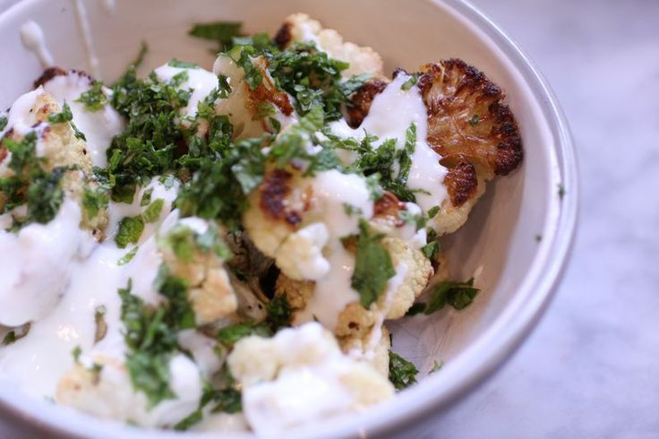roasted cauliflower with cumin topped with a dill y salty yogurt sour ...