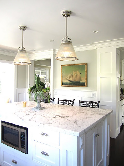 pale green/gray paint; white wainscoting + paneling; art (not loving the pendants)