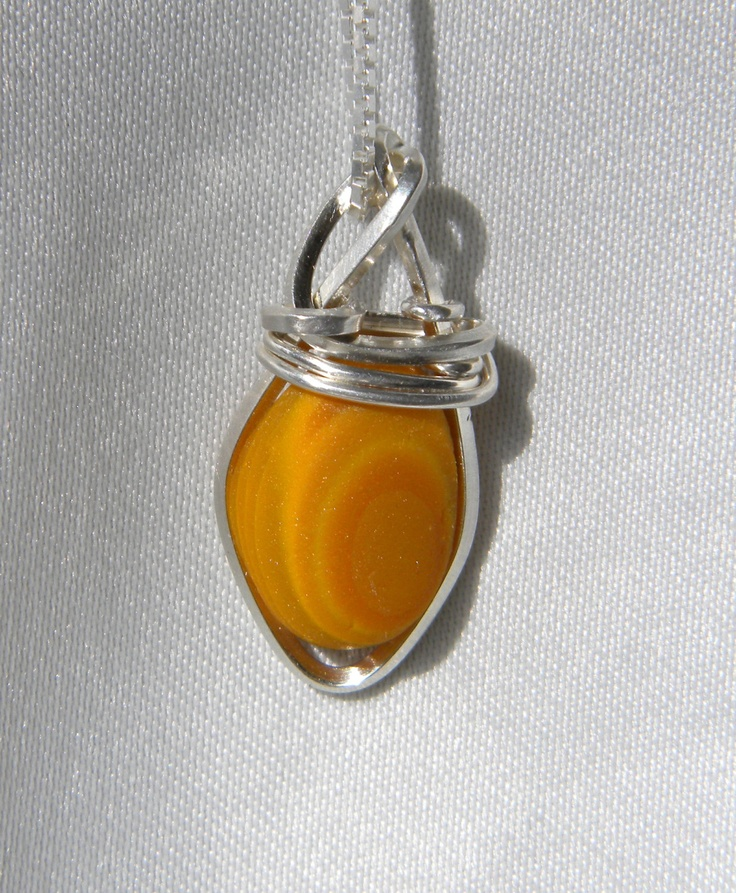 Sea Glass Necklace Orange Slag Wire Wrapped in Argentium Sterling Silver. $120.00, via Etsy.