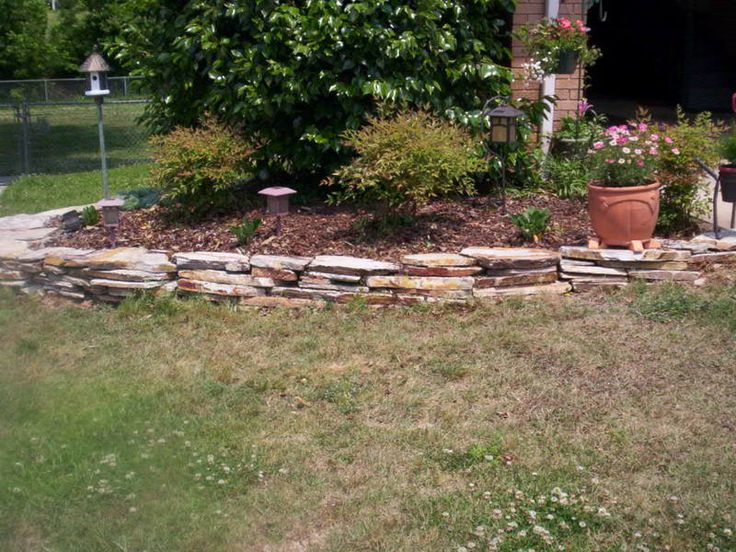Raised flower bed stacked flat stone border ideas for - Stone edging for garden beds ...
