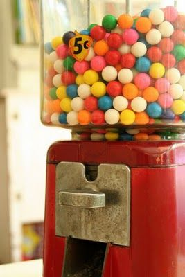 RED Bubble Gum Dispenser filled with rainbow gumballs