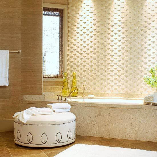 Artistic Bath  Across from the vanity in the previous slide, interesting convex tiles installed in a basket-weave pattern create a stunning backdrop to the smooth limestone tub surround. Accent lights turn the splash-proof wall into a contemporary sculpture.