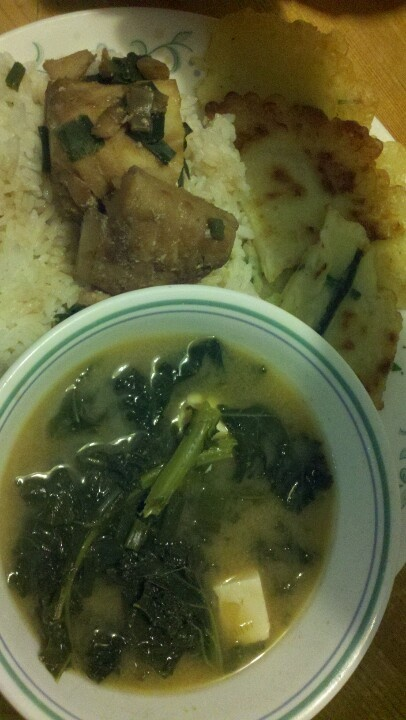 Miso soup with tofu, green onions and kale in veggie broth, steamed ...