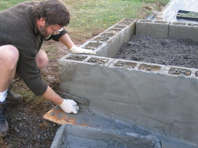 Cinder block w tinted stucco raised bed gardening for Concrete block stucco