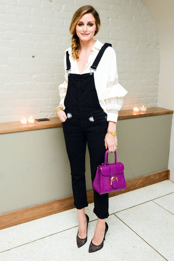 Olivia Palermo pairs a feminine blouse with a sporty overall. Click here for more style inspiration.