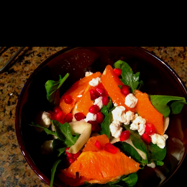 Fennel, arugula, orange, pomegranate, goat cheese salad with a citrus ...