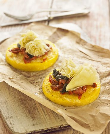 Polenta pizzas with Tête de Moine and sun dried tomatoes