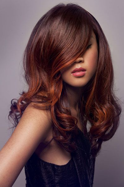 Stunning brown hair with tangerine highlights. perfect for summer