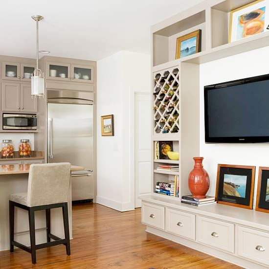 in a snap the open space in the center houses a wall mounted tv