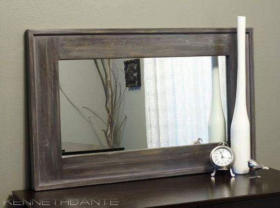 Grey framed mirror