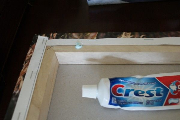 Clever!! What a great idea to hang a picture!! Put the toothpaste where you will want the nail to go. Then, press the picture to the wall where you want to hang it so that the toothpaste from the back of your frame sticks to the wall.  Why didn't I think of this? Just a great idea!!