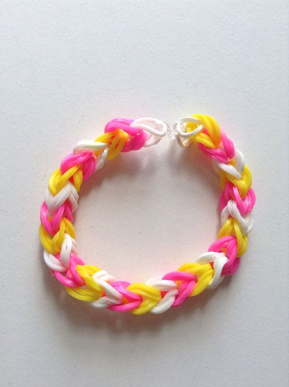 Pink yellow and white rubber band bracelet by cutiepiebracelet
