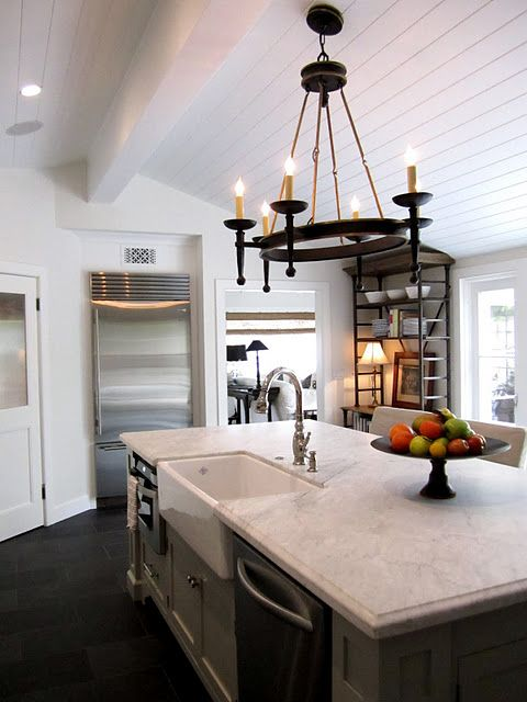 kitchen with farmhouse sink, white wood ceiling and slate floors