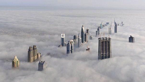 Dubai. The view from the skyscraper BurjKhalifa. The height of buildings is 828 m (163 floors).