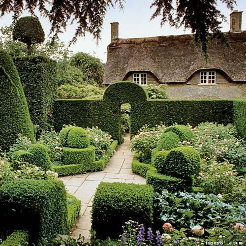 Wonderful English garden and look at the rolling curves of the thatched roofed cottage!